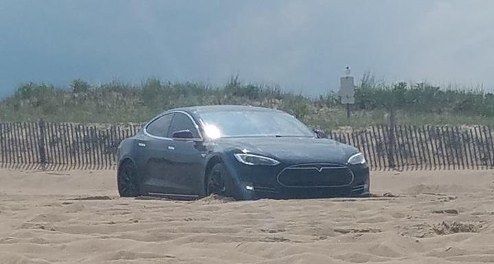 tesla, car stuckon beach,cape henlopen state park,